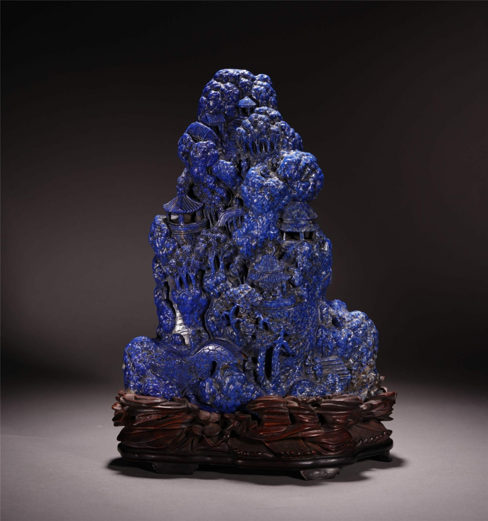 This extensively carved Chinese lapis scholar's rock on a rosewood stand brought $20,000 plus the buyer's premium in May 2020 at Bridgewater Auction.