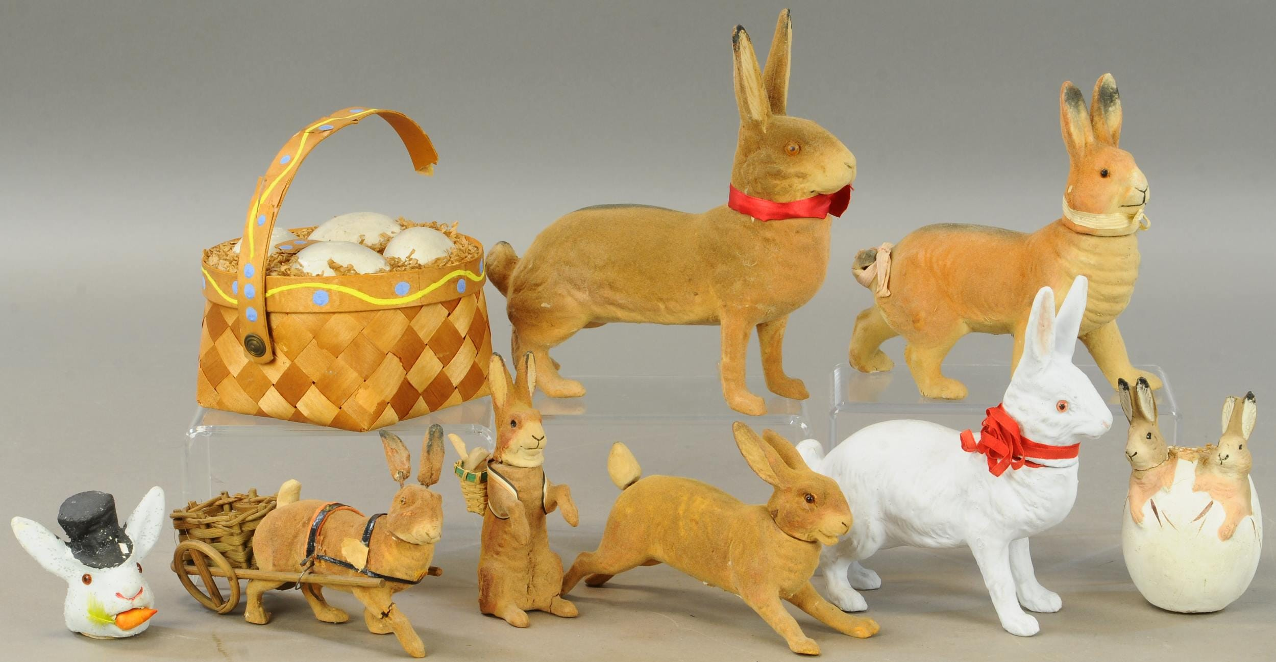 Antique rabbit candy containers are delicate, especially their ears. This warren of nine bunny candy containers plus an Easter basket with eggs all had some condition issues, except the all-white rabbit. The group lot fetched $1,800 plus the buyer's premium in December 2020 at Bertoia Auctions.