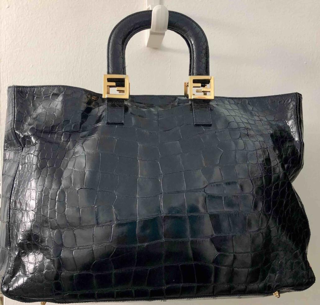 Fendi matte black crocodile tote bag with gold hardware, estimated at $1,000-$2,000