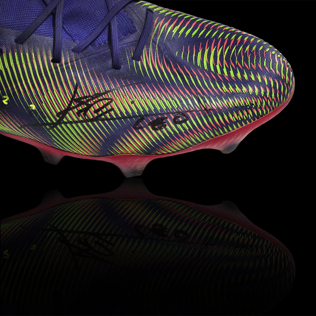 Messi signed the game-worn boots, which he auctioned to raise money for charity.