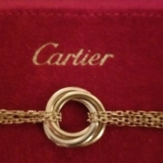 Cartier 18K gold trinity tri-color chain bracelet, estimated at $2,200-$3,500