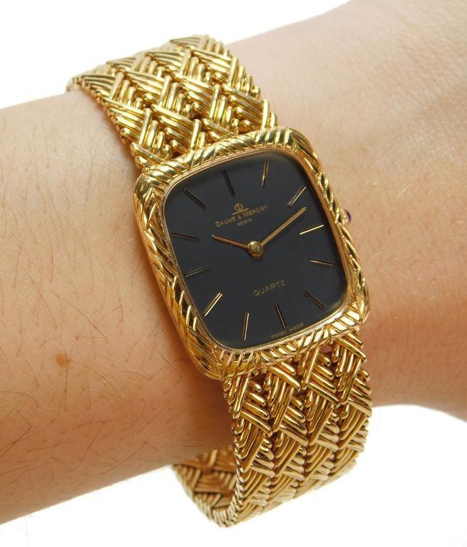 Baume & Mercier 14K gold watch, estimated at $2,000-$3,000