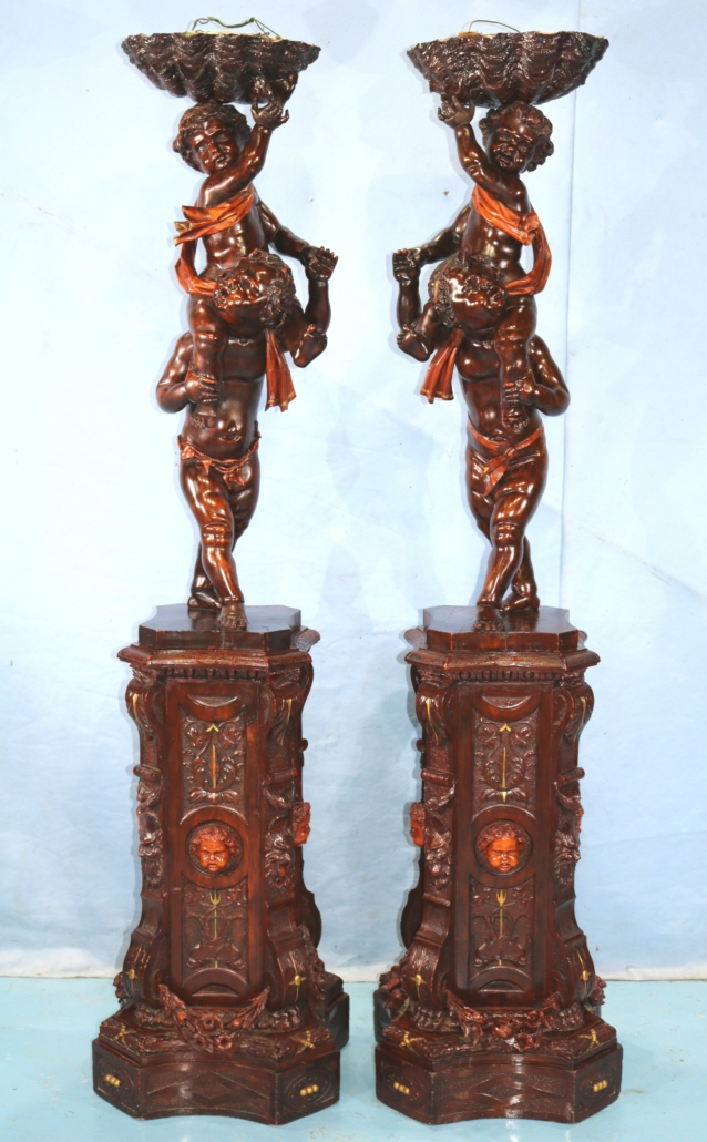 Renaissance Revival double carved putti, estimated at $20,000-$35,000