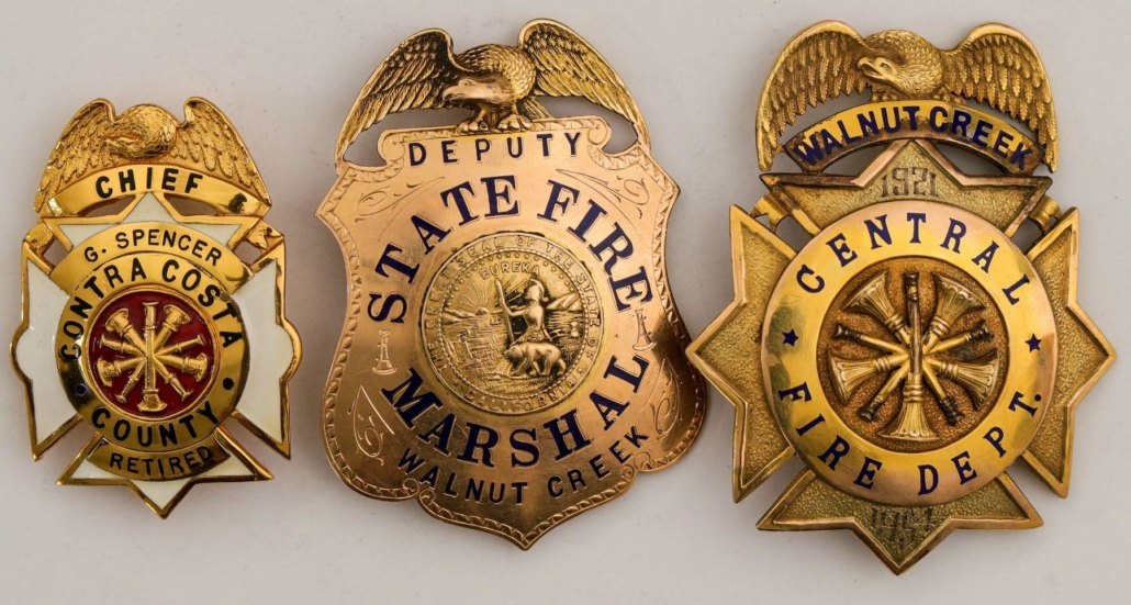 Archive of California fireman Fremont Spencer, including gold badges, photos and a gold Masonic card, estimated at $8,000-$10,000