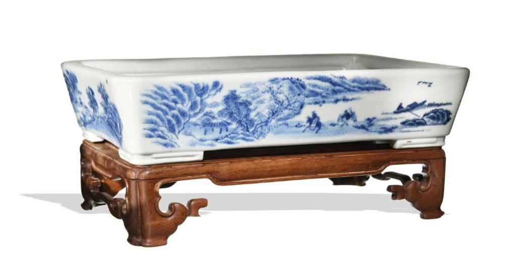 Chinese blue and white landscape planter with a hardwood stand, estimated at $20,000-$30,000