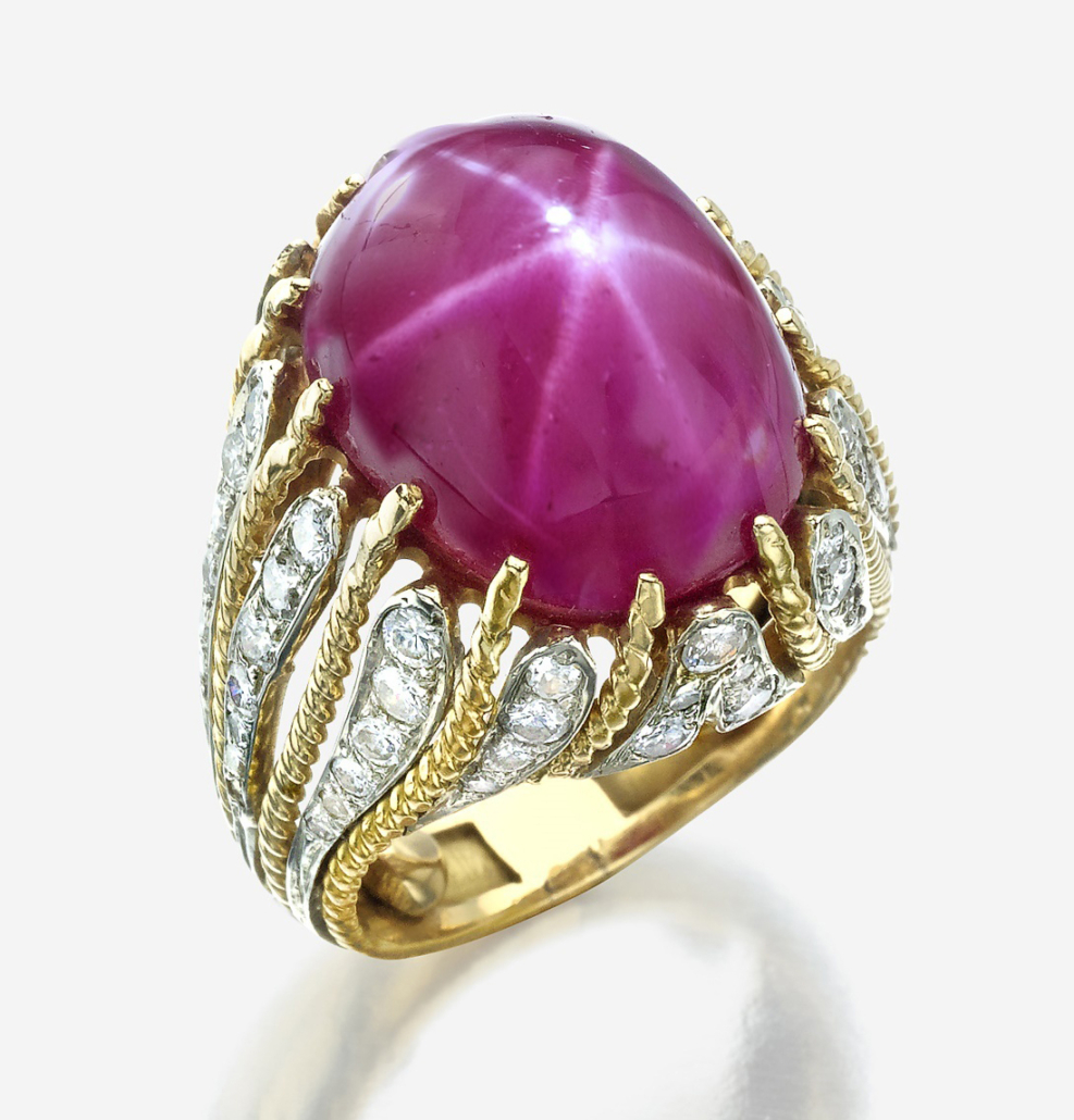 Diamond and 18K gold ring showcasing a Burmese star ruby, estimated at $10,000-$15,000