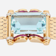 Retro aquamarine, ruby, and diamond bracelet in 14K gold, which sold for $12,500