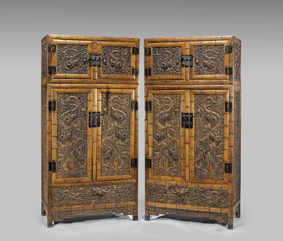 This pair of large and elaborately carved huanghuali cabinets sold for $27,500 plus the buyer's premium in November 2014 at I.M. Chait Gallery/Auctioneers.