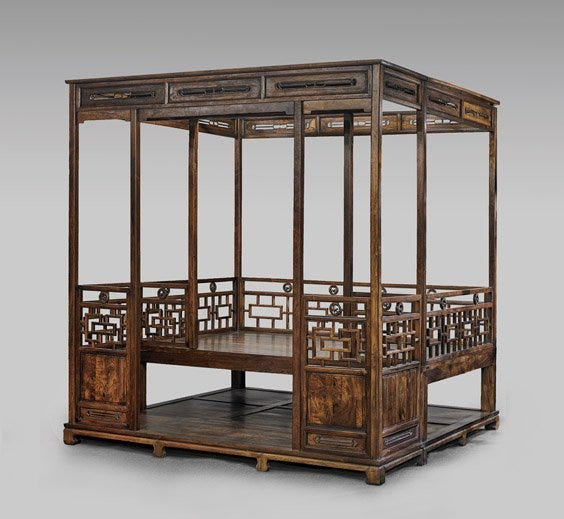 A large Chinese huanghuali canopy bed made $60,000 plus the buyer's premium in January 2015 at I.M. Chait Gallery/Auctioneers.