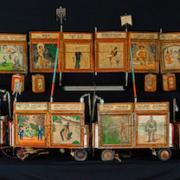 Folk art toy circus sideshow wagon train, estimated at $2,000-$3,000