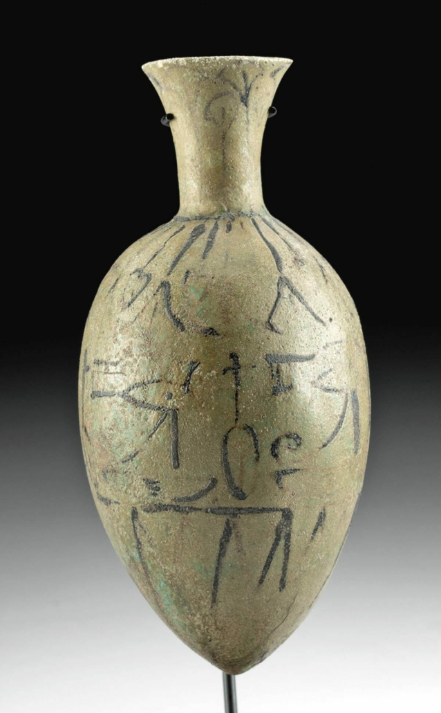 Ancient Egyptian late-18th-Dynasty Amarna faience lotus bottle with glyphs, estimated at $15,000-$20,000