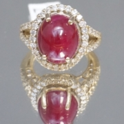 Large cabochon ruby and diamond ring, estimated at $9,000-$10,000
