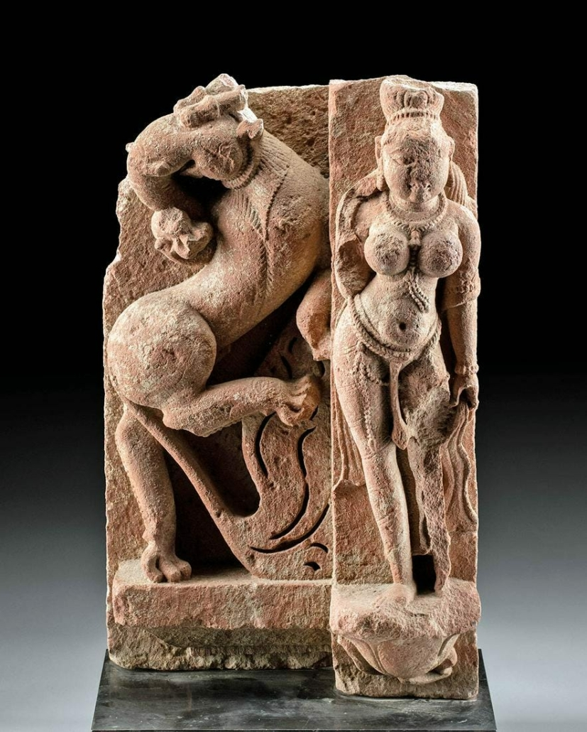 Indian Gupta dynasty red sandstone panel with high-relief figure of celestial or deity with a mythical gajasimha, estimated at $25,000-$35,000