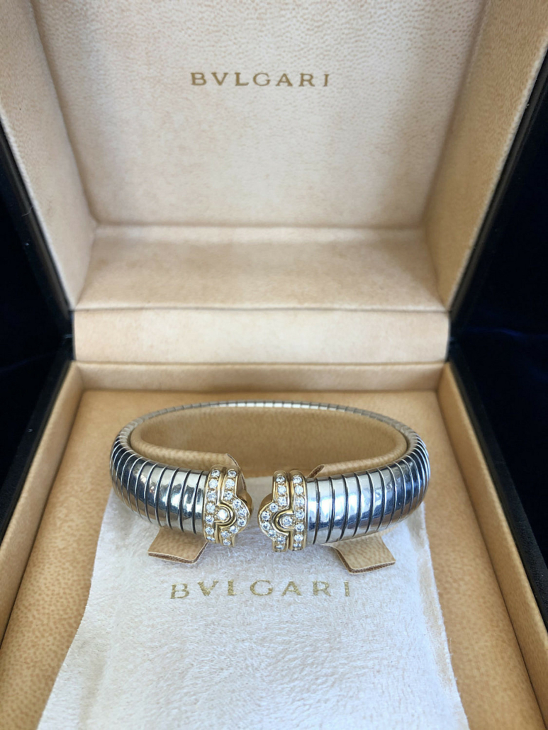 Bulgari Tubogas diamond cuff bracelets in steel and 18K yellow gold, each estimated at $3,000-$4,000