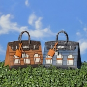 The matte bleu Faubourg Birkin 20 from the collection of JaneFindsTM, shown at the right, sold for $200,000 and top lot status in Christie's Handbags & Accessories: The New York Edit auction. Courtesy of Christie's Images LTD 2021