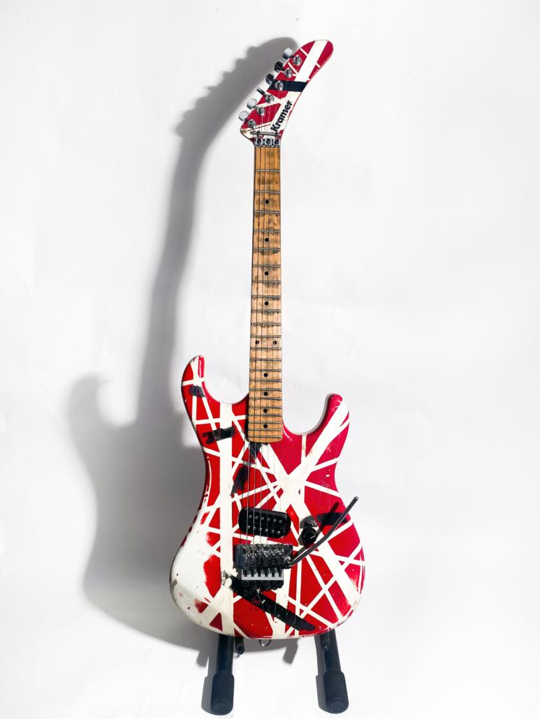 Eddie Van Halen red and white Stryper guitar, estimated at $150,000-$250,000