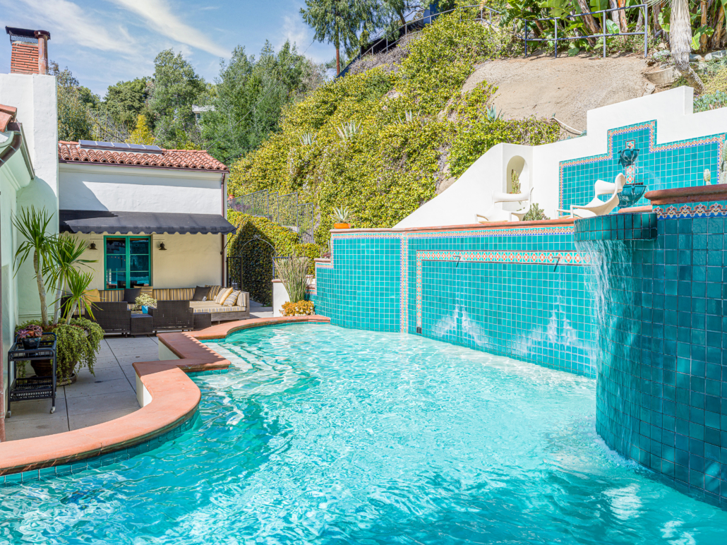 Sunlit pool on the grounds of the Los Angeles home that Leonardo DiCaprio bought for $7.1 million as a gift for his mother. Photo credit: Todd Goodman. Courtesy of TopTenRealEstateDeals.com