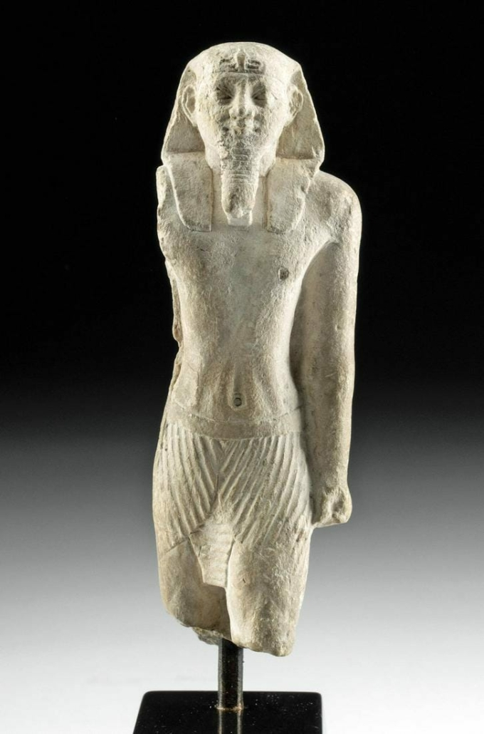 Ancient Egyptian sculpted limestone statue of striding pharaoh, 26th (Late Dynastic) Saite Period, circa 664-525 BCE, estimated at $50,000-$75,000