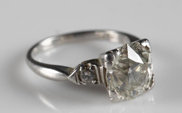 Platinum diamond ring with a 3.40 carat center diamond, estimated at $8,000-$12,000