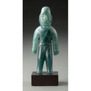 Olmec standing figure, carved in blue-green jade and estimated at $75,000-$100,000