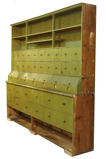 Green-painted country store dry goods cabinet, estimated at $7,500-$10,000