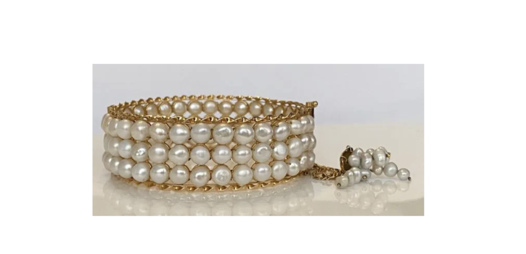 18K yellow gold bracelet graced with three strands of pearls, estimated at $2,500-$3,500