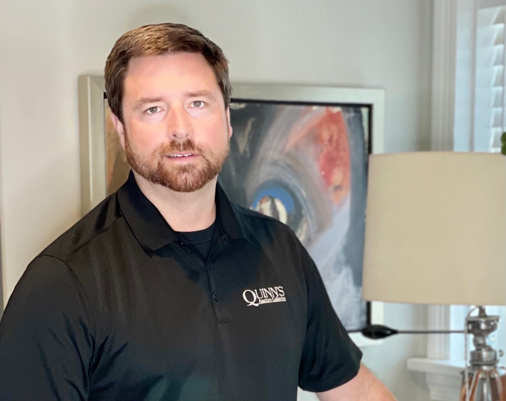 Pictured at home in front of a Merton Simpson artwork, Matt Quinn says by focusing on people and what client's needs are, he helps them through what can be a difficult time and maximizes their profit.