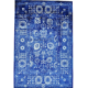 Oversize rug in luxurious shades of blue and white, estimated at $8,000-$10,000