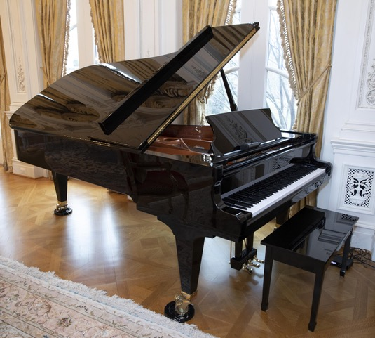 Schimmel Konzert K256 Tradition grand piano in a polished ebony finish, estimated at $10,000-$15,000