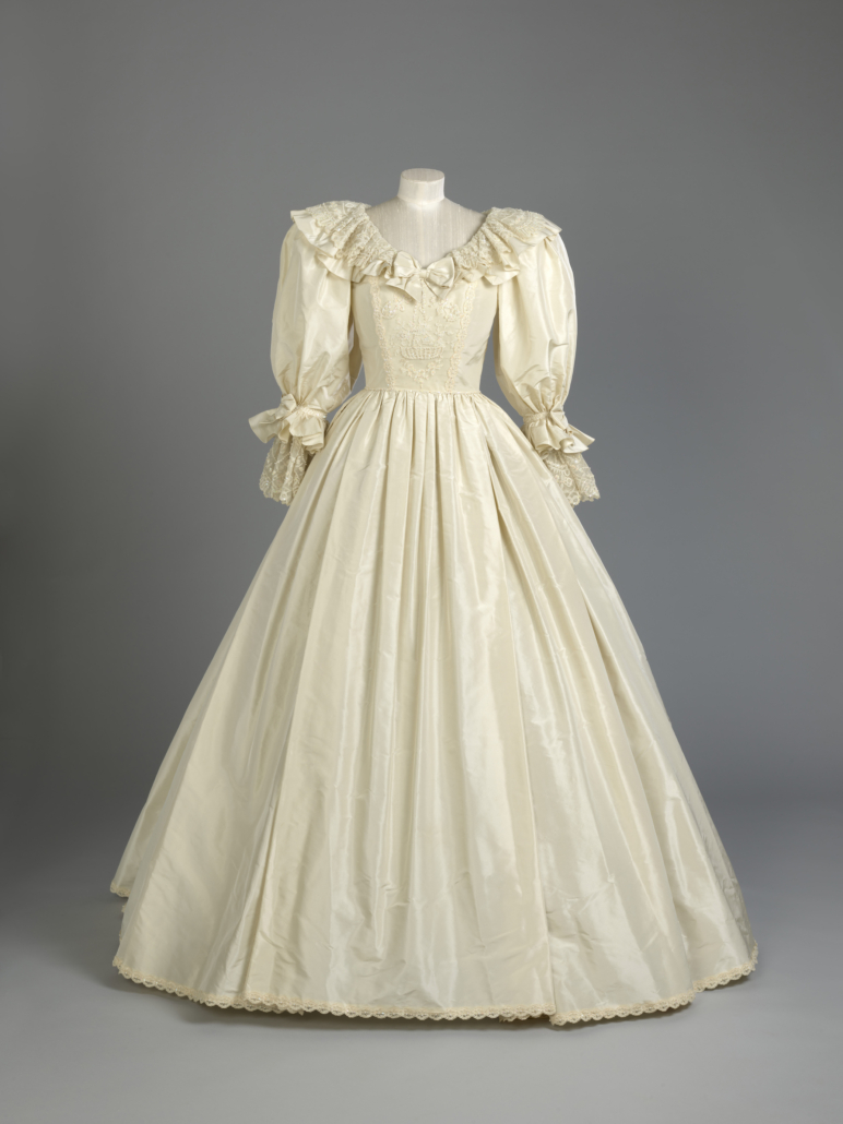 On view in Royal Style in the Making is Princess Diana's wedding gown. It features a fitted bodice overlaid with panels of antique Carrickmacross lace that had originally belonged to Queen Mary, the groom's great-grandmother. © Royal Collection Trust.