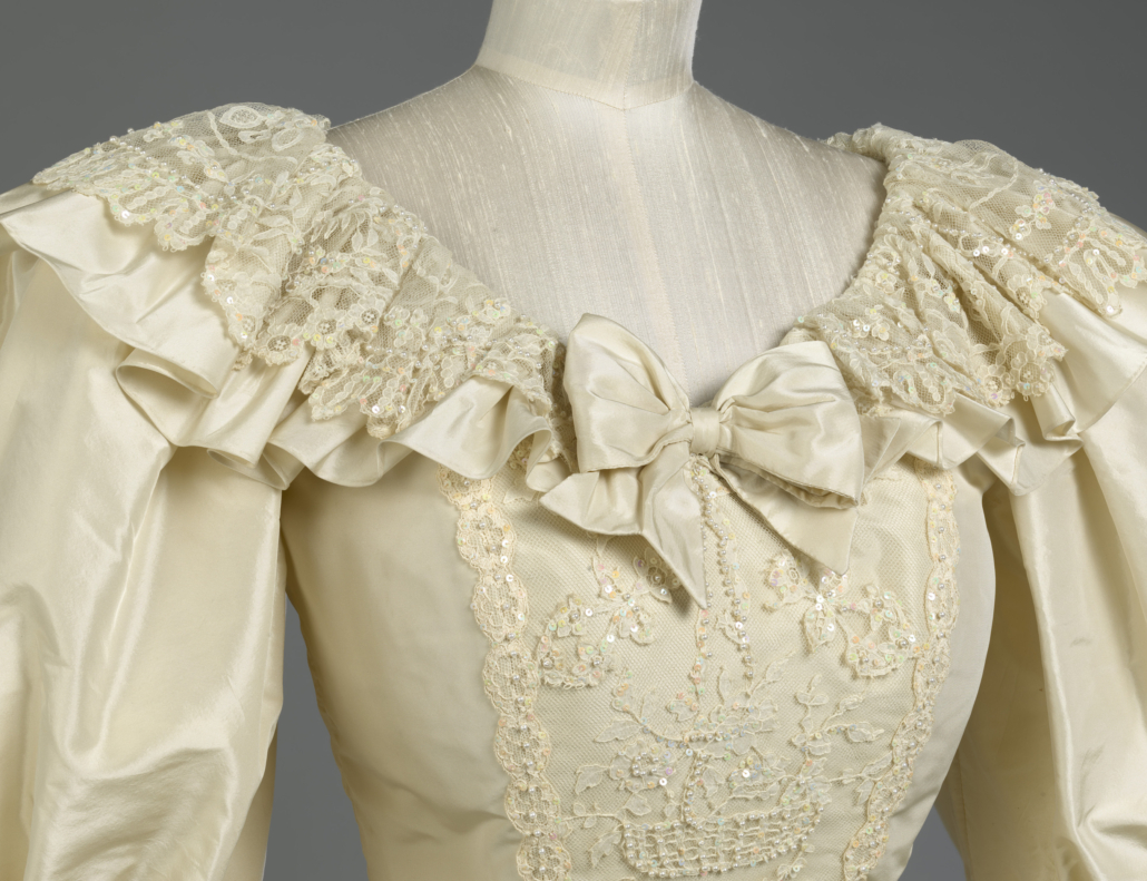 Detail image of the neckline of Princess Diana's wedding gown. © Royal Collection Trust.