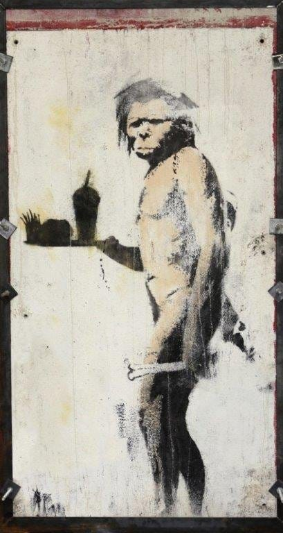 'The Caveman,' a 2008 stencil and colored spray on concrete wall in metal frame, went for $680,000 plus the buyer's premium in December 2018 at Fine Art Auctions Miami.