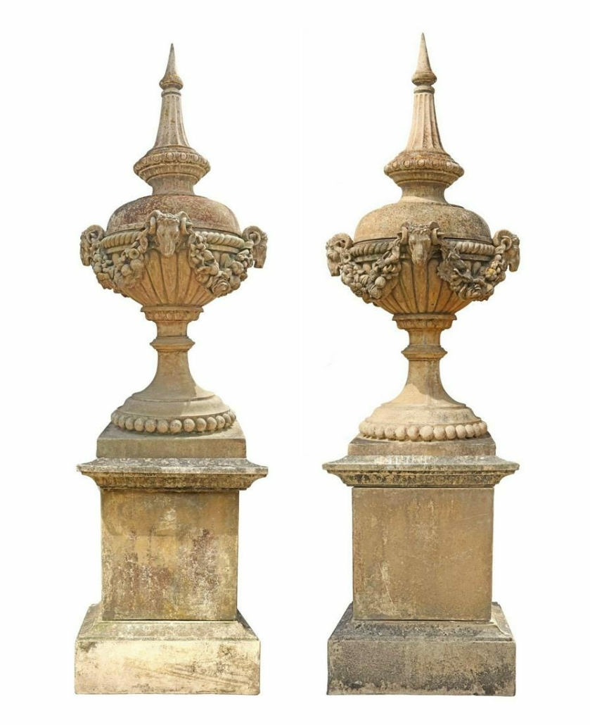 A pair of large cast stone garden statuary urns brought $16,000 plus the buyer's premium in May 2021 at Austin Auction Gallery.