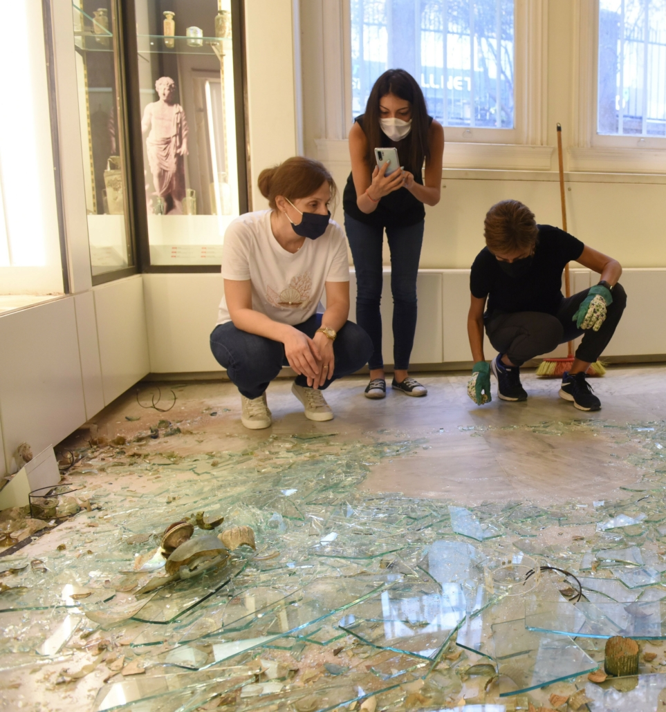 Archaeological Museum Curator Nadine Panayot (right) assessing the fallen display case. Courtesy of the AUB Office of Communications and Archaeological Museum