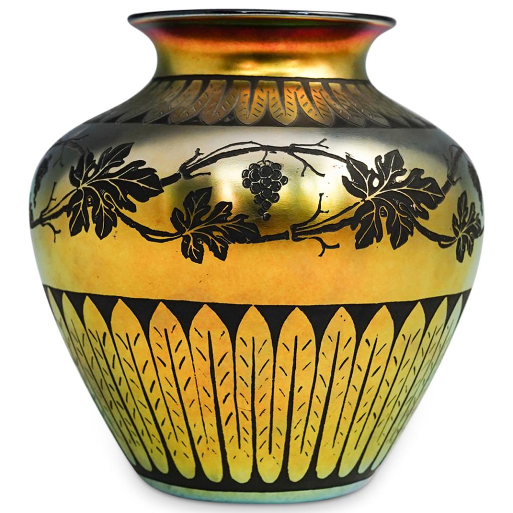 Steuben gold Aurene vase cut to black in the Norfolk pattern, estimated at $1,000-$5,000