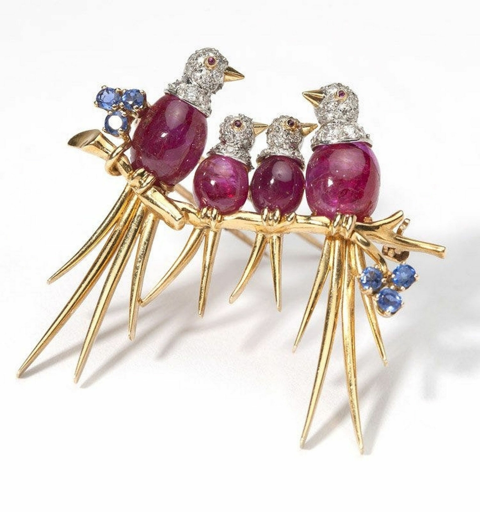This Van Cleef & Arpels gold and platinum bird brooch, featuring ruby cabochon bodies and a branch set with blue sapphires, sold for $22,000 plus the buyer's premium in 2014.