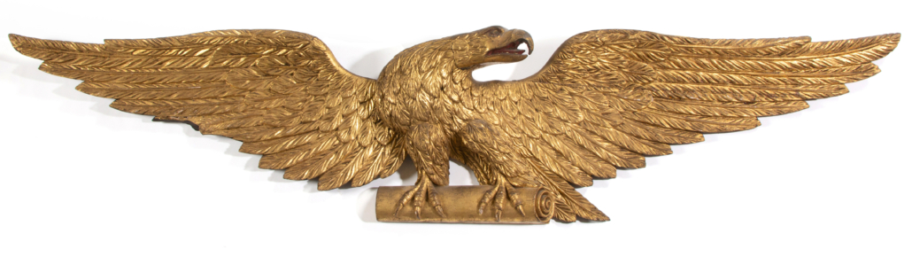 Mid-19th century carved and gilt eagle wall plaque, which sold for $14,040