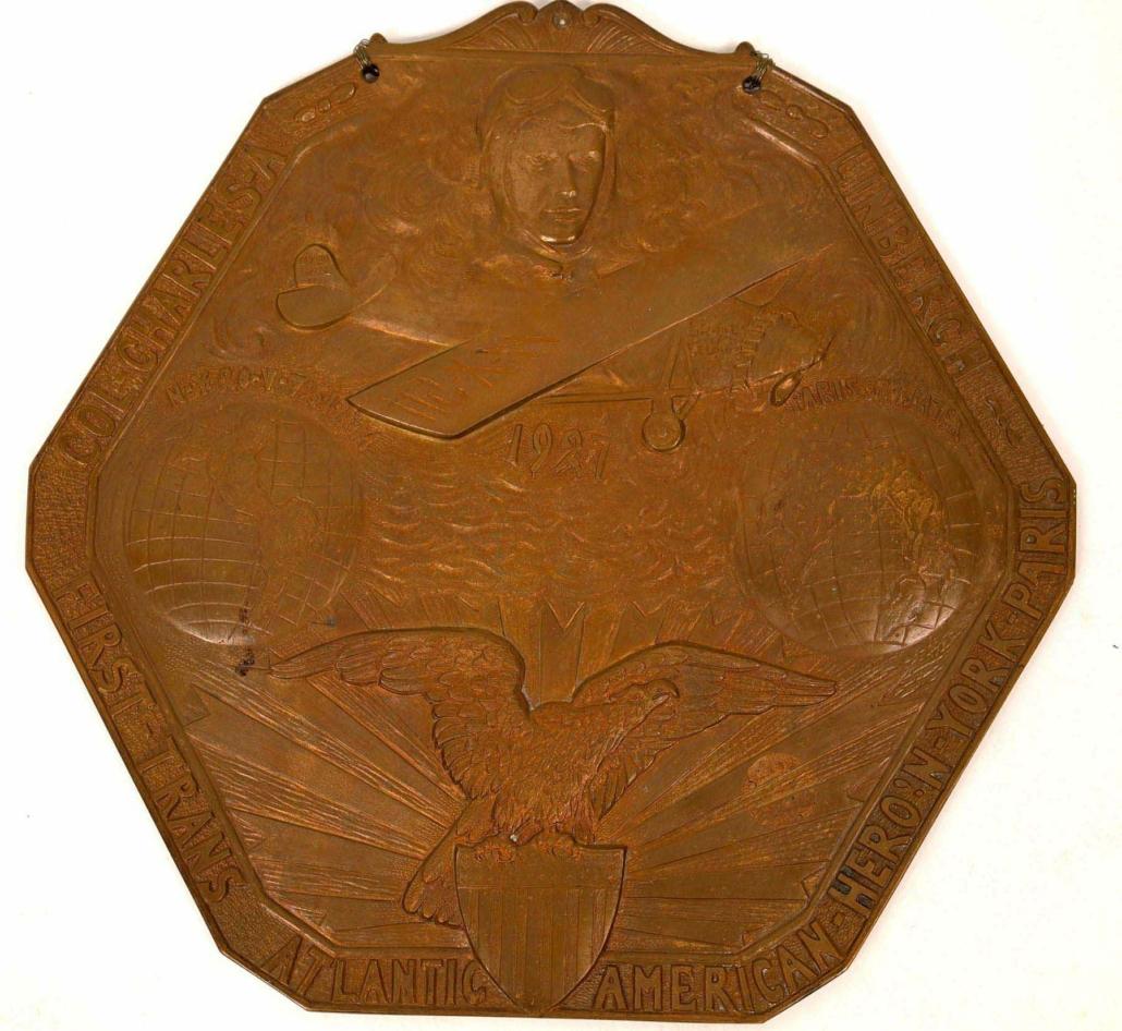 Bronze plaque celebrating Charles Lindbergh's 1927 flight, estimated at $3,000-$6.000