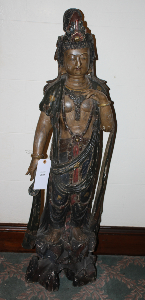 Late 19 th century carved Quan Yen figure, estimated at $2,000-$3,000