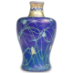Steuben iridized sapphire blue over flint white vase decorated with gold Aurene leaf-and-vine and Intarsia collar, estimated at $2,000-$20,000
