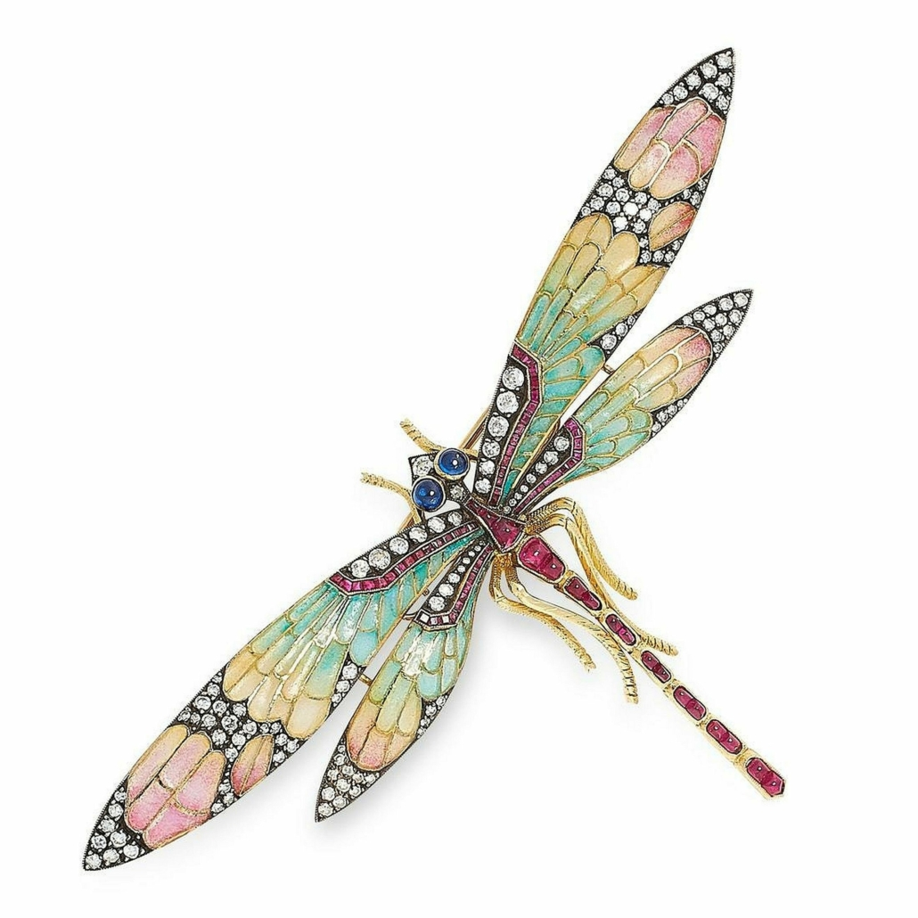An Art Nouveau dragonfly Brooch, in yellow gold, with diamonds, rubies, sapphires and plique-a-jour wings sold for £12,000 plus the buyer's premium in 2020.