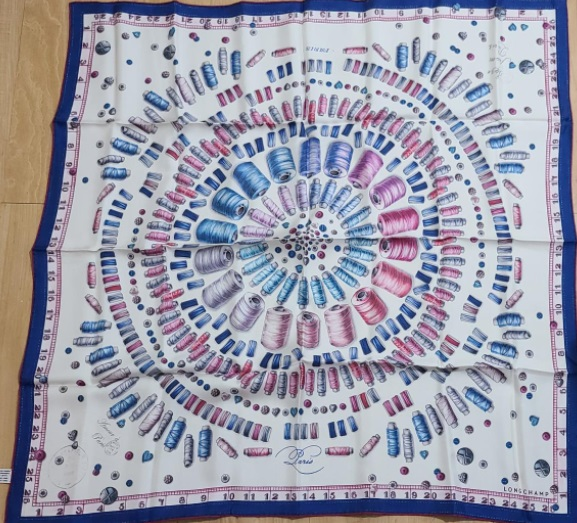 Longchamp silk scarf decorated with images of sewing notions, estimated at $75-$5,000