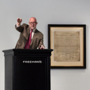 Alasdair Nichol, chairman and director of fine art at Freeman's, serves as auctioneer during the July 1 sale of the 1823 copy of the Declaration of Independence, which sold for $4.42 million.