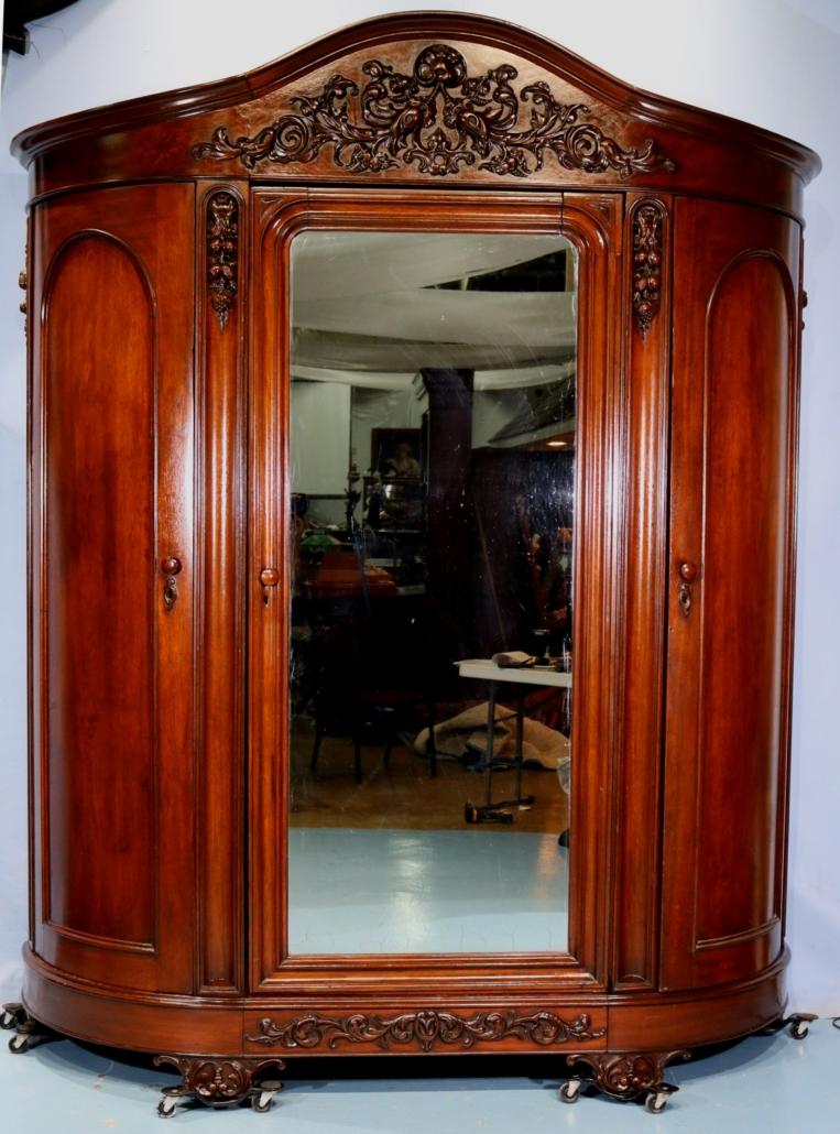 Oversize Victorian walnut three-door wardrobe attributed to J. H. Belter, estimated at $2,500-$3,500