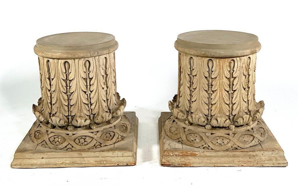 Pair of pine columnar capitals in the Corinthian style, estimated at $3,000-$5,000