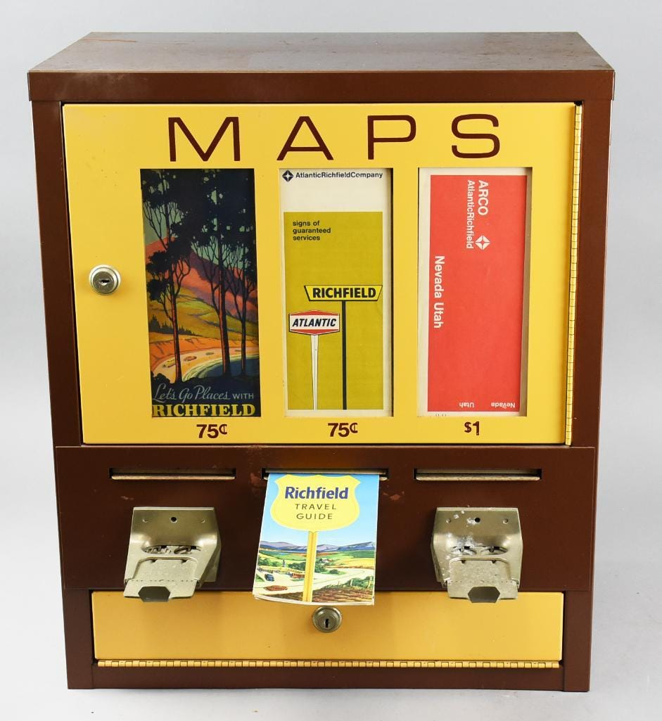 Vintage coin-op vending machine filled with 54 maps from the 1930s to the 1970s, showing the progression from Richfield to Atlantic Richfield to ARCO, estimated at $200-$600