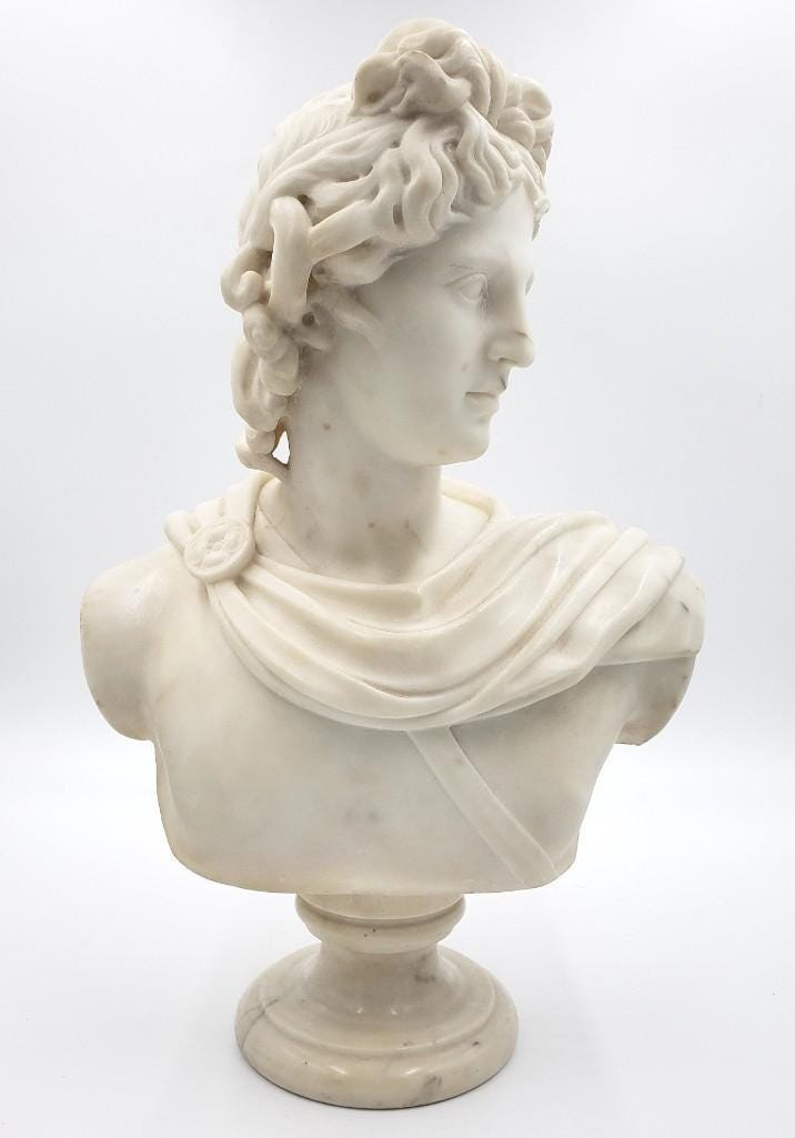Carved marble bust of Antonius, unsigned and raised on a small marble socle, estimated at $1,500-$2,500