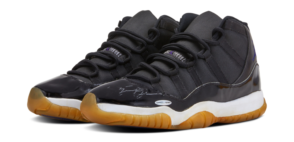 A pair of 'Player Sample' deadstock Air Jordan 11 'Space Jam' sneakers, signed by Michael Jordan, are estimated at $150,000-$200,000. Image courtesy of Sotheby's.