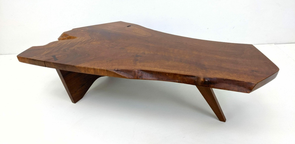George Nakashima single slab American walnut table with one butterfly joint from the Katherine Mezger collection, estimated at $5,000-$8,000