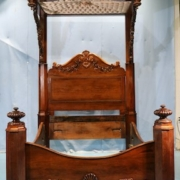 Rosewood rococo half tester plantation bed attributed to P. Mallard, estimated at $8,500-$15,000